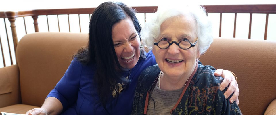 Kimberly laughing with a Resident